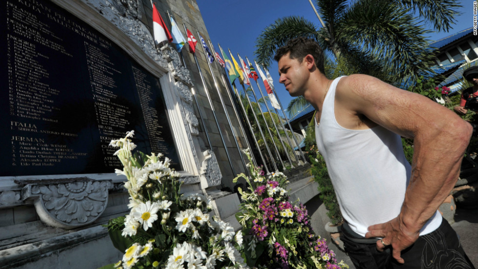 Survivor Phil Britten looks at the names of dead victims at a memorial monument three days before a ceremony to remember those killed. He was just 22 years old and had only been in Bali a few hours when he was caught in the blast and suffered burns to 60% of his body.