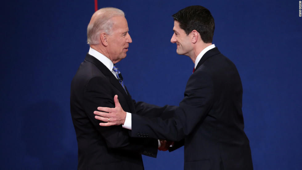 Vice President Joe Biden, left, shakes hands with Republican vice presidential candidate Paul Ryan before the vice presidential debate.