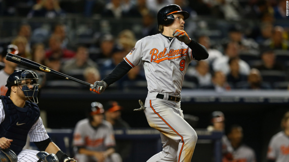 Baltimore Orioles outfielder Nate McLouth smashes a solo home run during the fifth inning of Thursday night's American League Division Series game against the Yankees in New York.