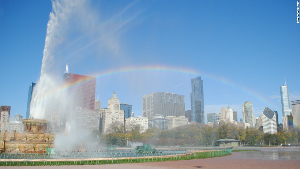 A rainbow frames the Chicago skyline with the Buckingham Fountain in Grant Park, downtown.