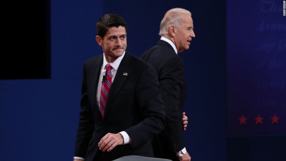 Vice President Joe Biden and U.S. Rep. Paul Ryan walk off stage after the vice presidential debate.