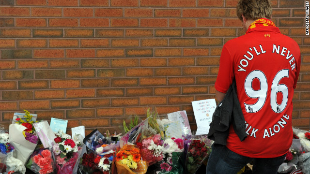 A Liverpool fan pays his respects outside the club's ground at Anfield, Liverpool on September 23, 2012.