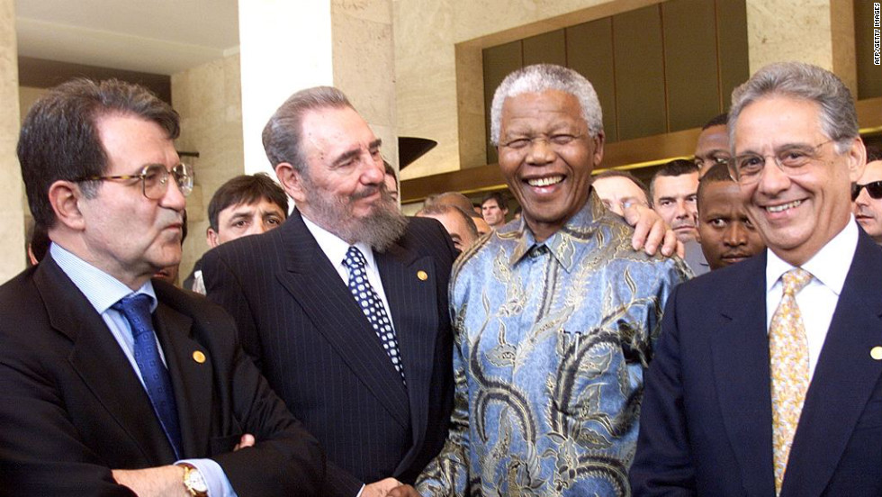 Castro puts his arm around South African President Nelson Mandela in May 1998, near Italian Prime Minister Romano Prodi, left, and Brazilian President Fernando Henrique Cardoso. They were in Geneva, Switzerland, for a conference of the World Trade Organization.