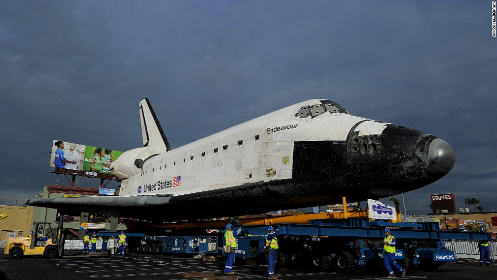 Workers check the space shuttle Endeavour as it rests at Westchester Square on Friday.