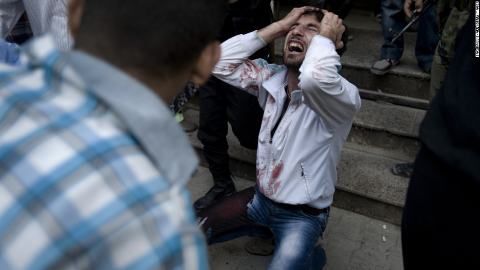 A Syrian man mourns the death of his father, who was killed during a government attack in Aleppo on October 10, 2012.