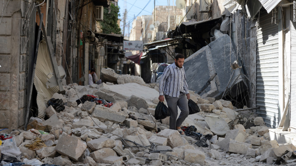 A Syrian man walks through rubble in Aleppo on Thursday.