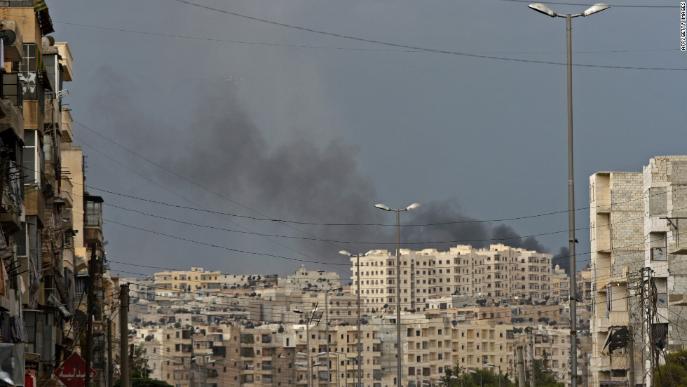 Smoke billows from buildings following shelling by government forces in Aleppo on Thursday.