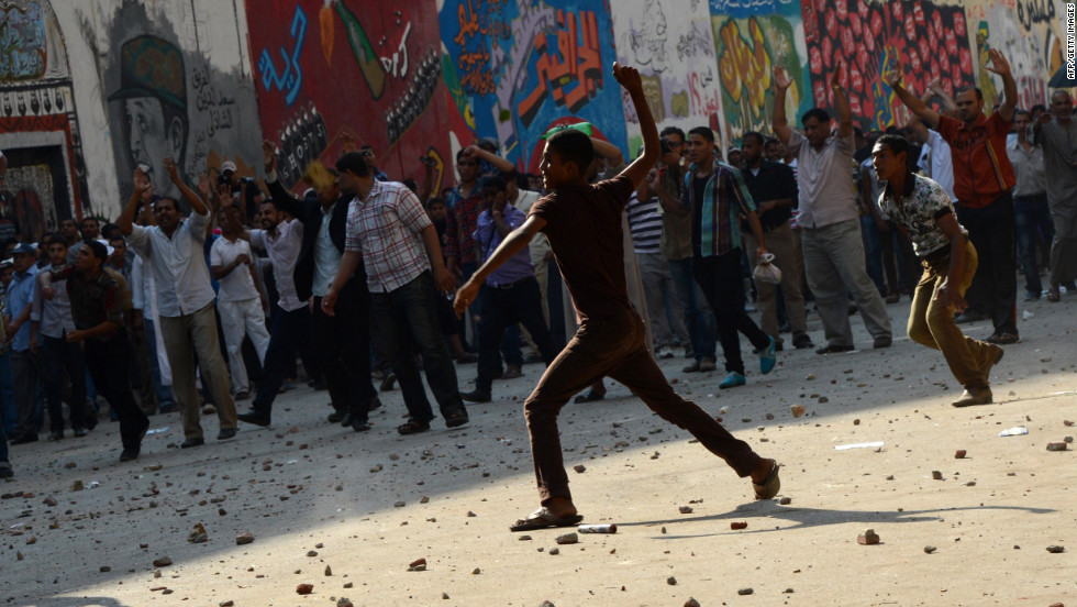 The health ministry said at least 12 people were wounded as protesters showered each other with stones after Morsy supporters tore down a podium from which anti-Brotherhood chants were being orchestrated.