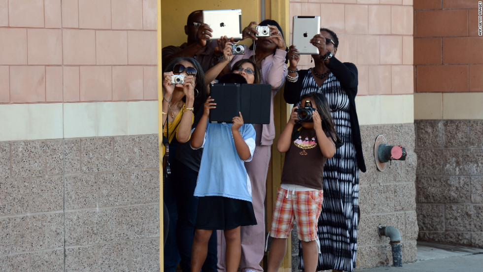 A crowd gathers to take pictures of Endeavour passing through Inglewood on Saturday.