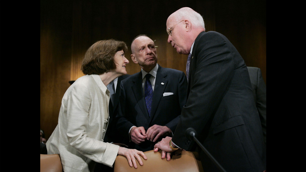 Specter, center, greets U.S. District Judge Joan Lefkow, left, with Sen. Patrick Leahy of Vermont at a hearing in May 2005.