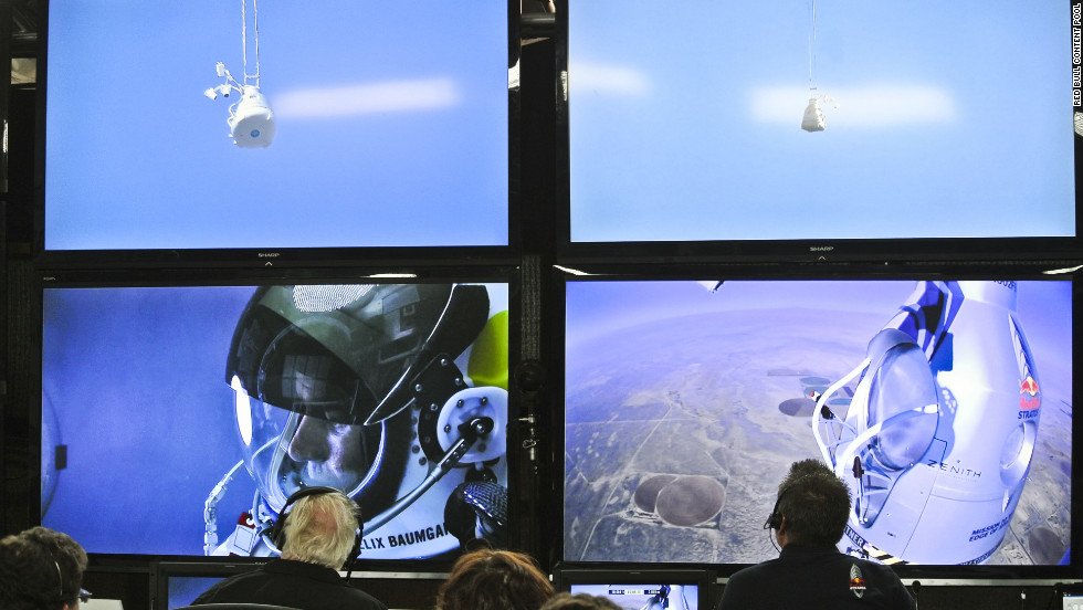 People at the mission control center in Roswell, New Mexico, watch Baumgartner during his ascent on Sunday.