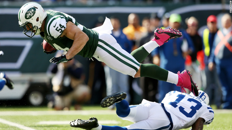 Nick Bellore of the New York Jets is tripped up by T.Y. Hilton of the Indianapolis Colts.