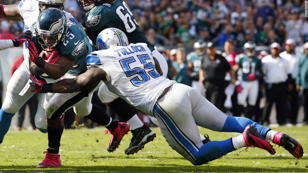 LeSean McCoy of Philadelphia is tackled in the end zone by Stephen Tulloch of Detroit.