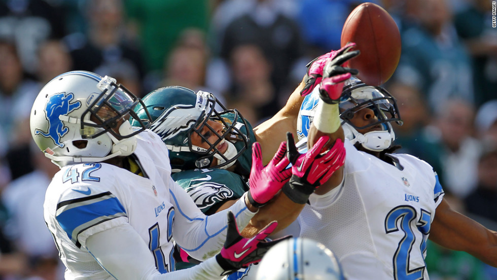 A pass intended for wide receiver Riley Cooper of the Philadelphia Eagles is broken up in the end zone by Amari Spievey, left, and Chris Houston of the Detroit Lions on Sunday.