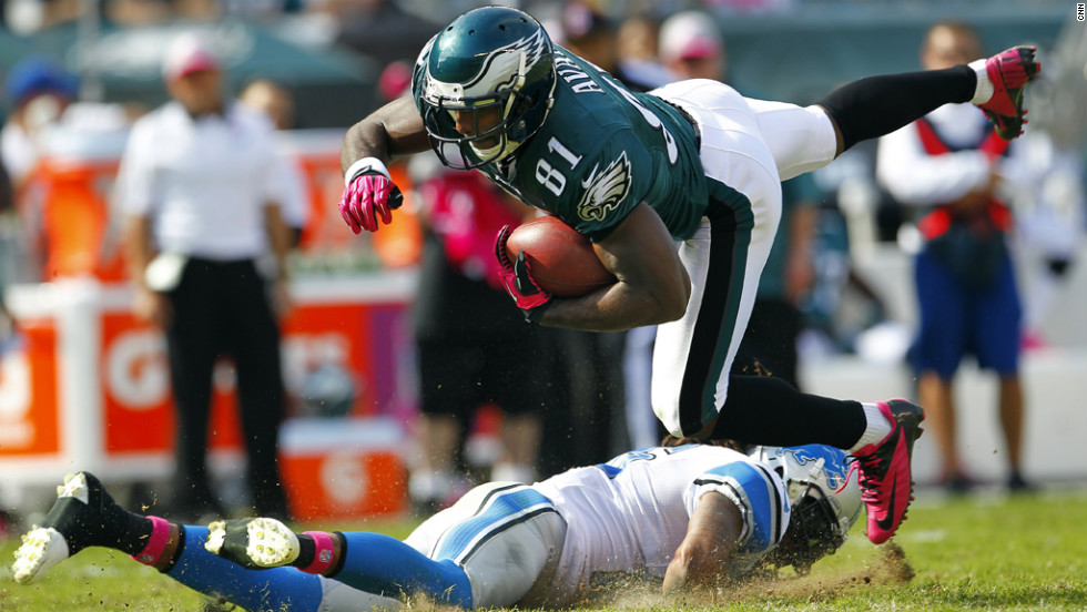 Jason Avant of the Philadelphia Eagles is tackled by Louis Delmas of the Detroit Lions after making a catch in the first half.