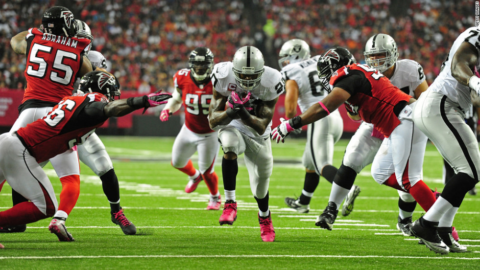 Darren McFadden of the Oakland Raiders carries the ball against the Atlanta Falcons.