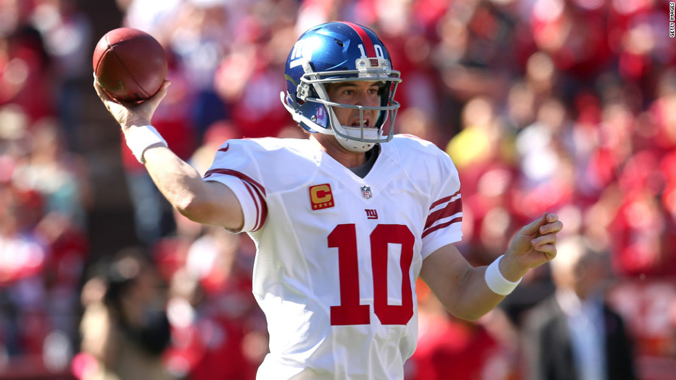 Quarterback Eli Manning of the New York Giants throws a pass against the San Francisco 49ers.