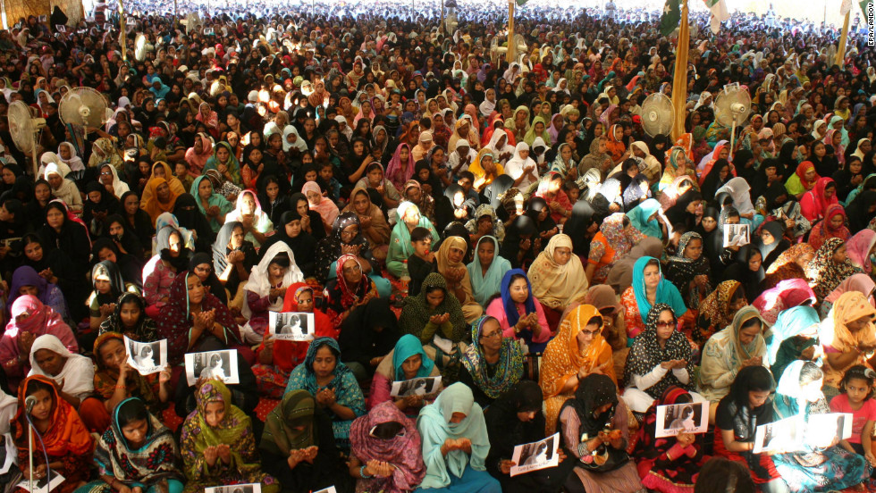 Supporters hold portraits of Malala as they pray for her well-being in Karachi, Pakistan in 2012. Malala gained fame for blogging about how girls should have rights in Pakistan, including the right to learn.