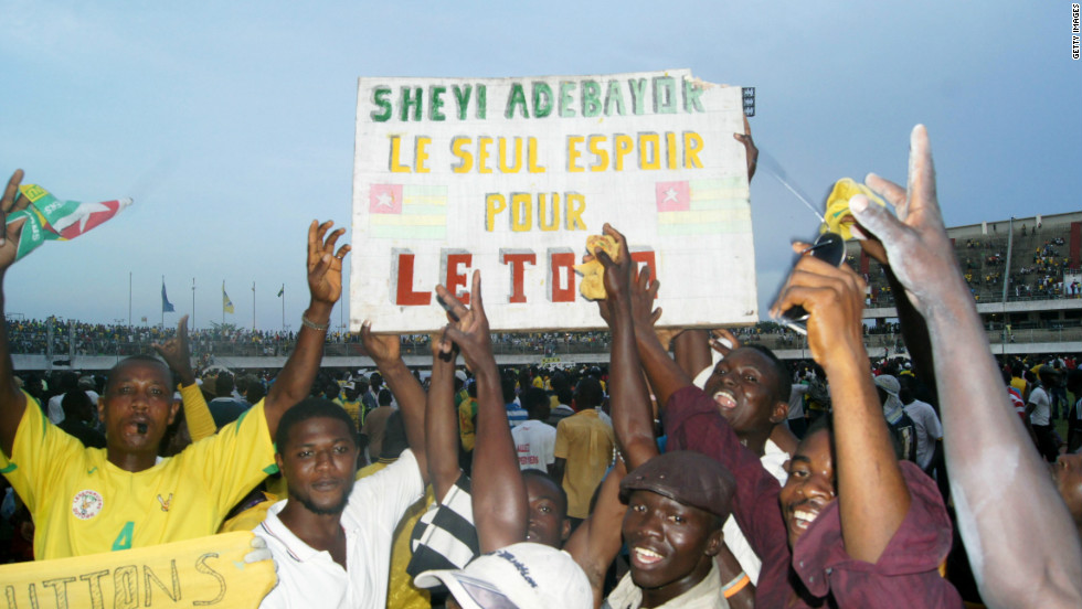 "Togo's star player is Tottenham Hotspur striker Emmanuel Adebayor. He is reverred by the country's football fans, with this banner saying: ""Adebayor: Togo's only hope""."
