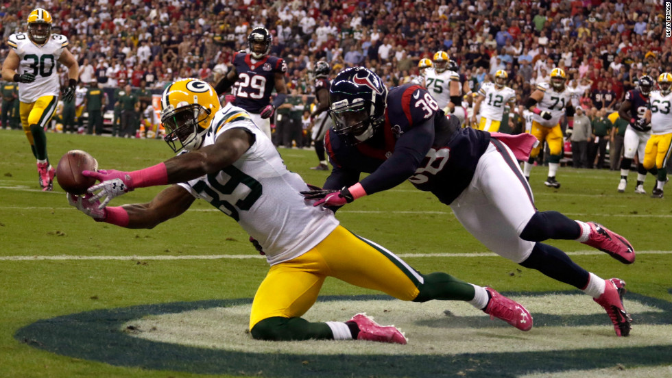 James Jones of the Packers catches a pass for a touchdown in the first quarter against Texans defender Danieal Manning.