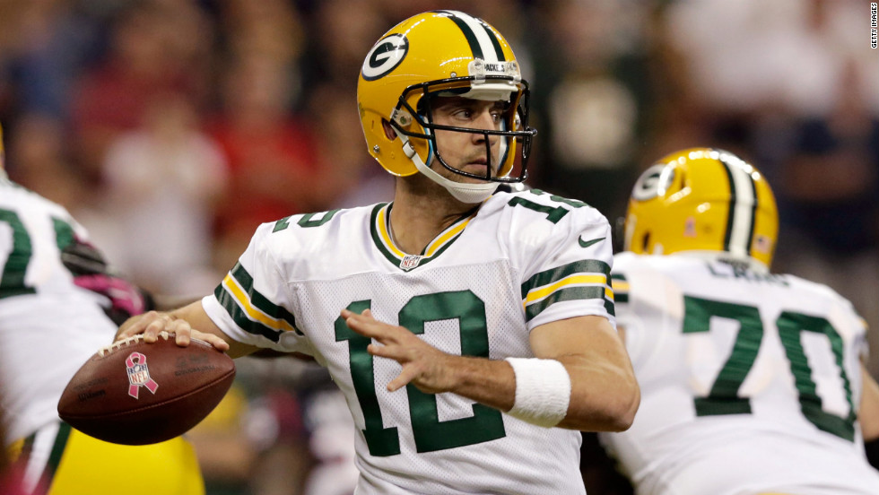 Packers quarterback Aaron Rodgers looks to pass during Sunday's game against the Texans.