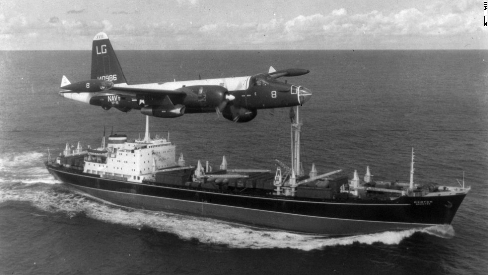 A P2V Neptune U.S. patrol plane flies over a Soviet freighter in 1962.