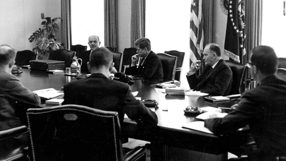 President John F. Kennedy meets with aides.