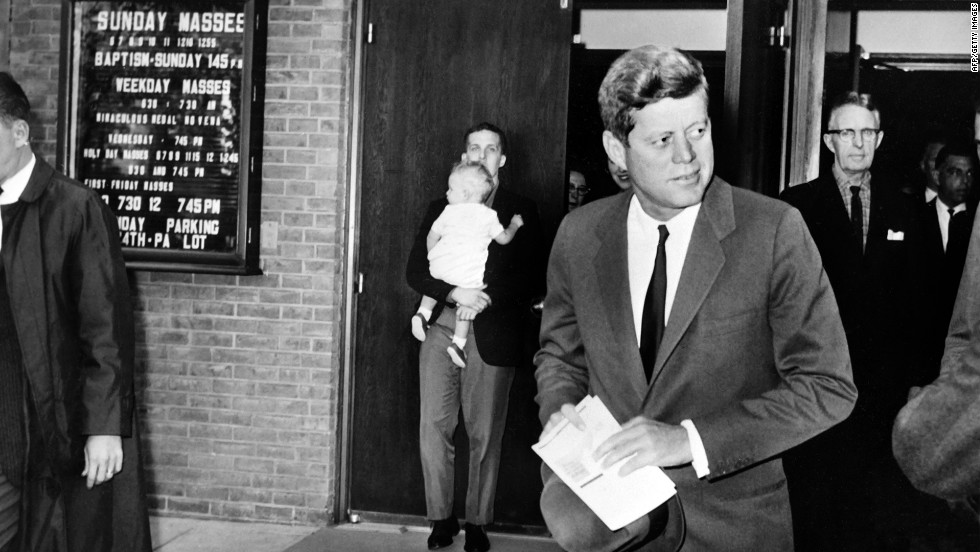 President John F. Kennedy leaves St. Stephen Martyr Catholic Church after attending mass on October 29, 1962, in Washington, just a few hours before the Cuban missile crisis began to resolve peacefully.