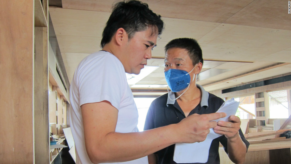 Samuel Wong, left, gives directions to one of his employees.