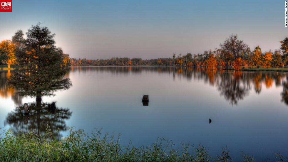"<a href=""http://ireport.cnn.com/docs/DOC-853145"">Jacobson Park Reservoir</a> reflects the fall trees around its smooth surface."