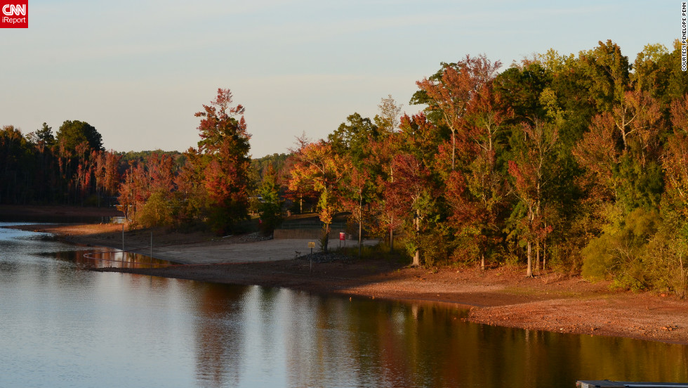 "A range of fall colors is reflected in this lake in <a href=""http://ireport.cnn.com/docs/DOC-858299"">Clarksville, Virginia</a>."