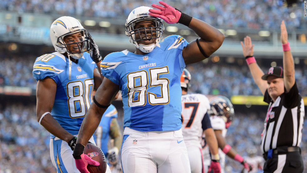 Antonio Gates of the San Diego Chargers, center, celebrates his touchdown against the Denver Broncos.