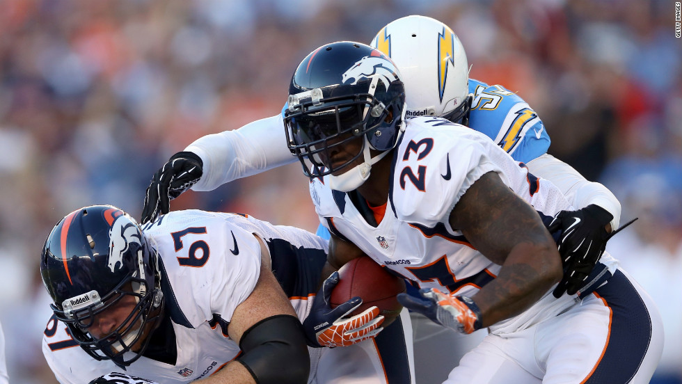 Willis McGahee of the Broncos looks for room to run alongside teammate Dan Koppen, left.