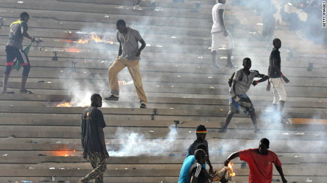 Fans set fire to the stands in Dakar on Saturday, as Ivory Coast's second goal effectively eliminated the hosts from the 2013 Africa Cup of Nations, with the Confederation of African Football disqualifying Senegal from the tournament on Tuesday.