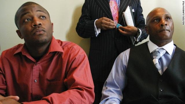 Christopher Johnson, left,  and Nathaniel Claybrooks talk to the media during a press conference about the lawsuit on April 18.