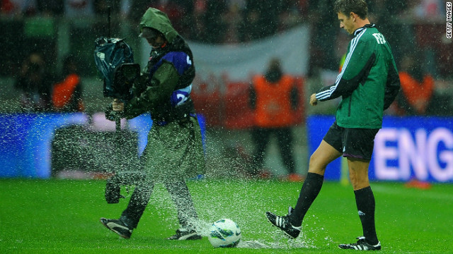 Match referee Gianluca Rocchi inspects the pitch prior to canceling Tuesday's World Cup Qualifier between Poland and England.