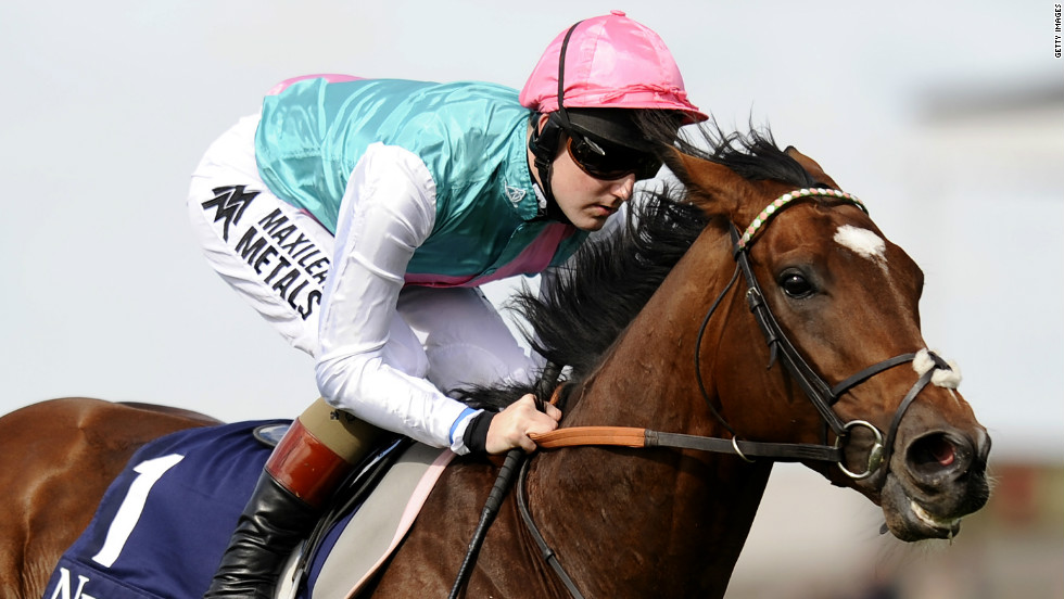 Jockey Tom Queally riding Frankel in a racecourse gallop before racing at Newmarket racecourse on September 29, 2012 in Newmarket, where his first filly was born.