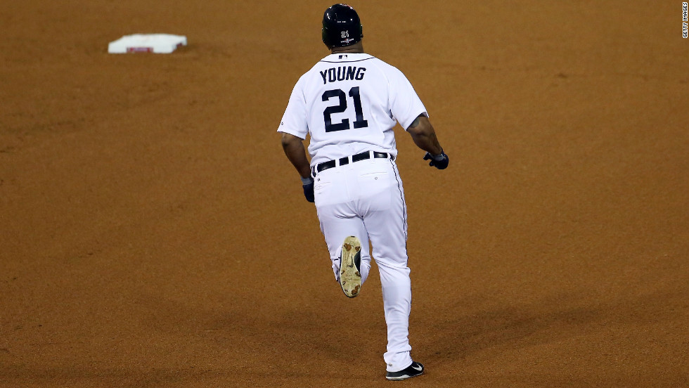 Delmon Young of the Detroit Tigers rounds bases after hitting a solo home run.