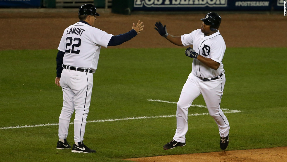Delmon Young of the Detroit Tigers greets third base coach Gene Lamont as he makes his way around the bases after hitting a solo home run in the bottom of the fourth inning.