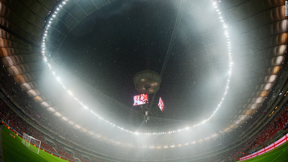 The roof ot the national stadium in Warsaw remained open on Tuesday as heavy rain put pay to any hopes of England's World Cup qualifier against Poland taking place at the first time of asking.