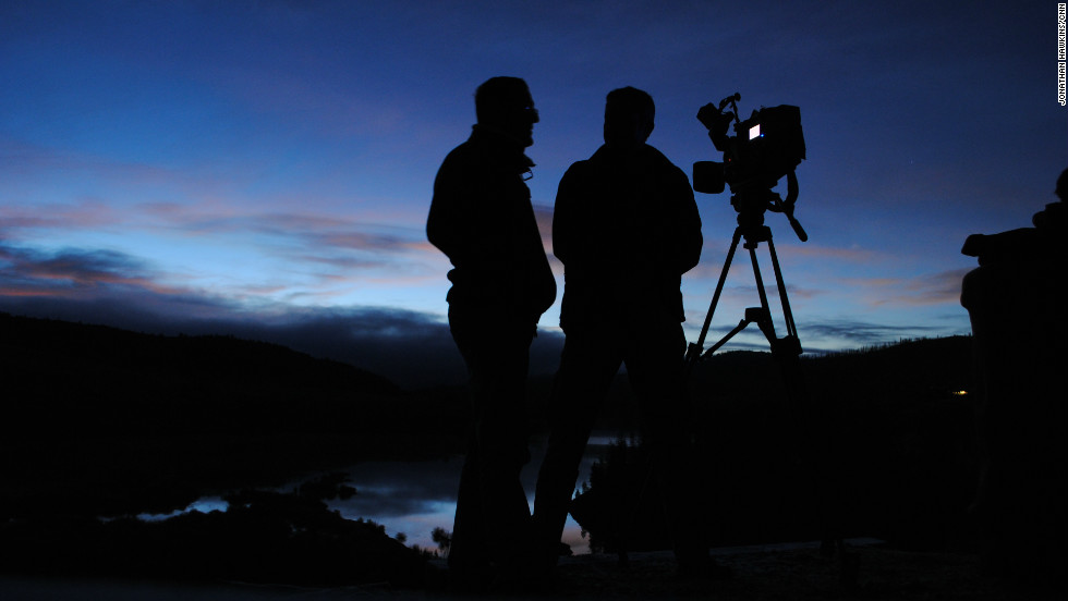 Richard Quest and cameraman Christian Streib watch the sun rise over Granby, Colorado.