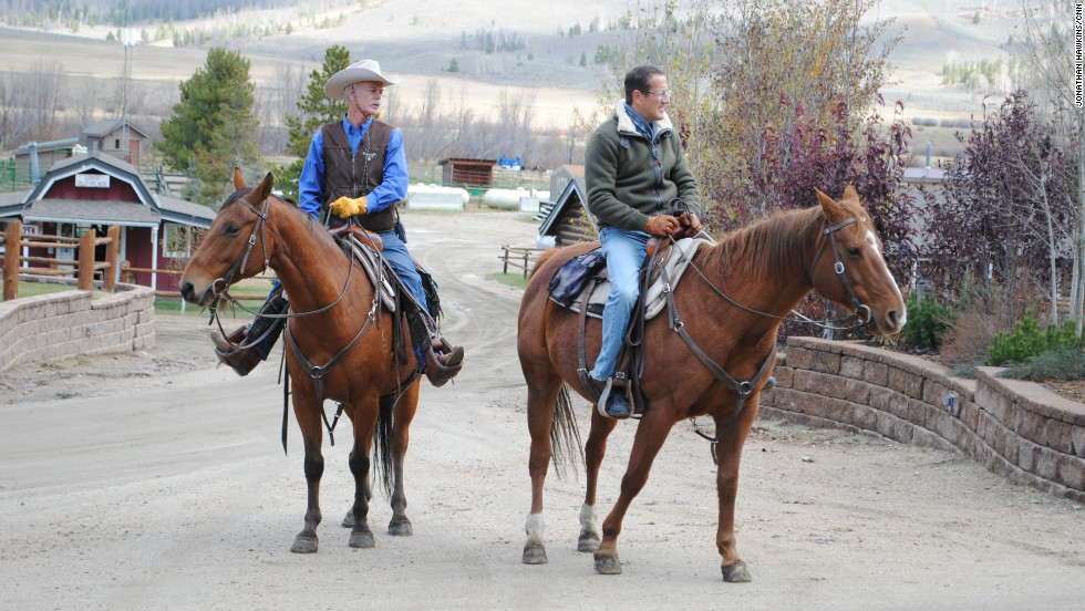 Richard Quest with rancher Connie Dorsey on horseback in Grandby, Colorado.
