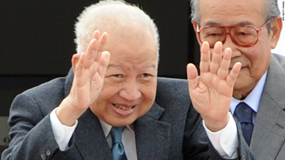 A photo from January 19, 2012, shows the former King Sihanouk bidding farewell to government officials as he boards a plane for Beijing at Phnom Penh International Airport. He had stepped down in 2004 because of health problems, but Cambodia's National Assembly then gave Sihanouk the title of King Father, allowing him the same privileges he had as the reigning monarch.