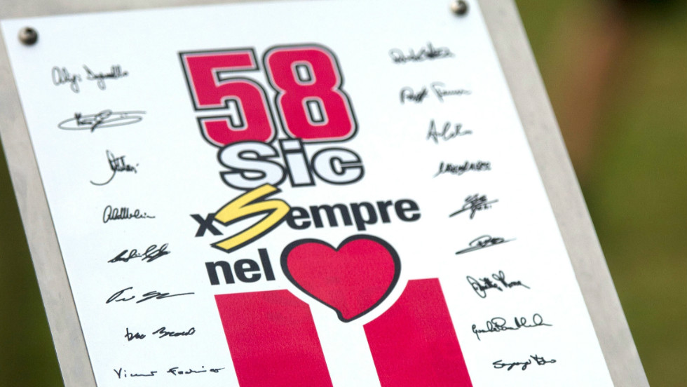 The whole of the MotoGP world stopped in silence at the unveiling of a plaque in memory of the Italian during the ''Tribute for Marco Simoncelli' ahead of the race in Malaysia. The number '58' which was Simoncelli's number and his nickname 'Sic' are both included on the memorial.