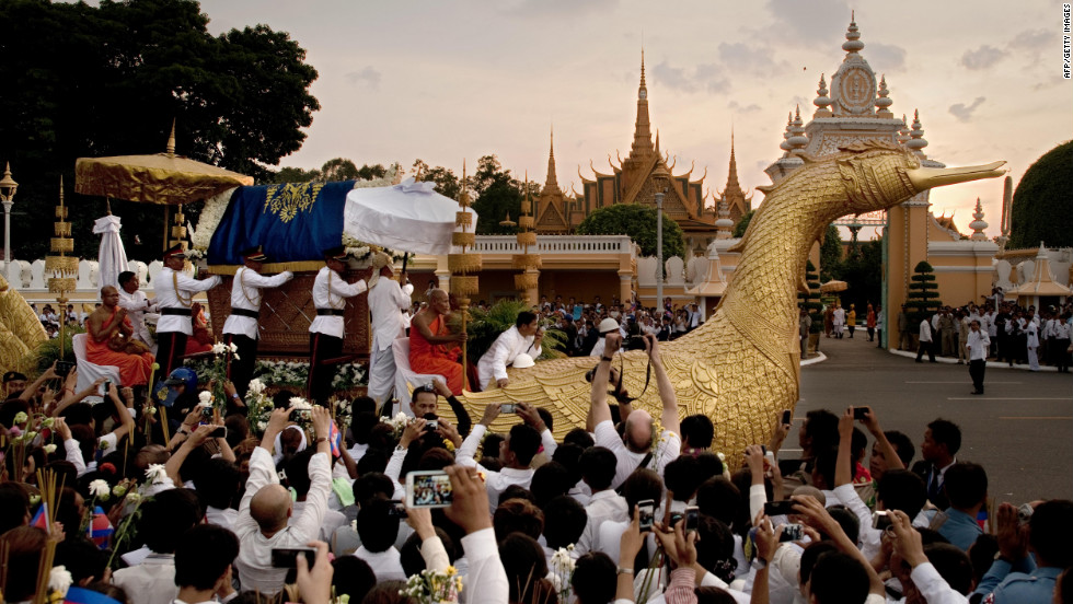 The coffin of late king is seen on a golden float shaped like a mythological bird, as it passes in front of the Royal Palace in Phnom Penh on Wednesday, October 17. A convoy took the king's body back to Cambodia from Beijing, where he died on Monday at 89.