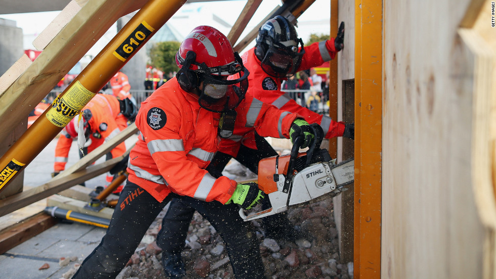 Members of the Urban Search and Rescue unit saw through wood during a demonstration.
