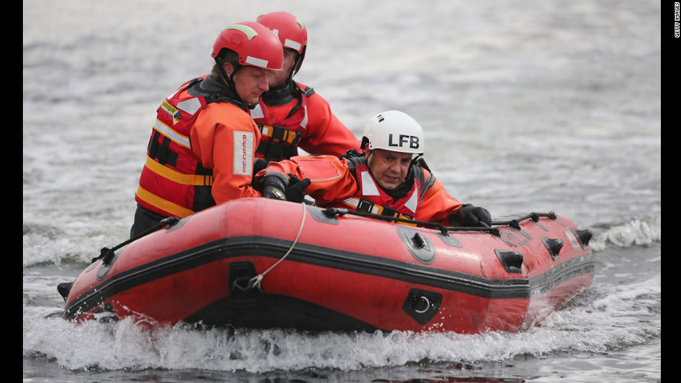 Participants of the contest ride in a boat during a water rescue challenge.