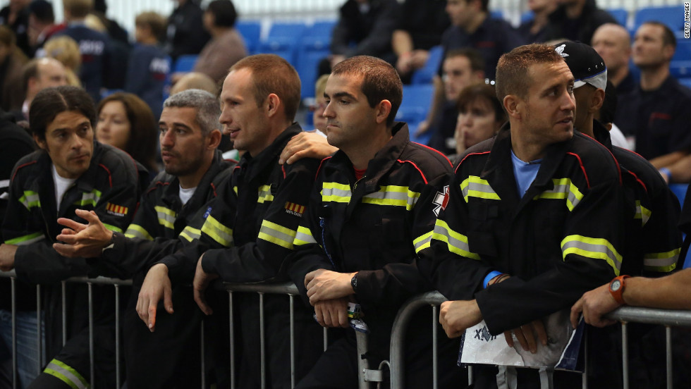 Members of the Fire Brigade watch a challenge take place.