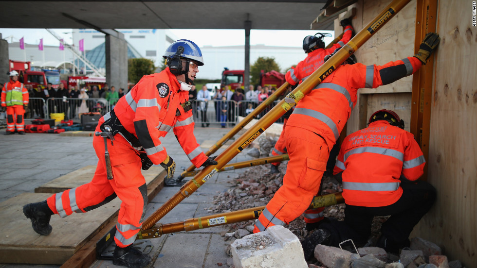 Members of the Urban Search and Rescue unit work together.