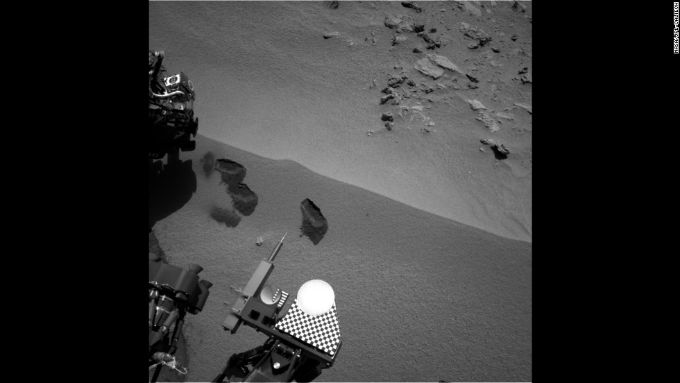"Three ""bite marks"" made by the rover's scoop can be seen in the soil on Mars surface on October 15, 2012."